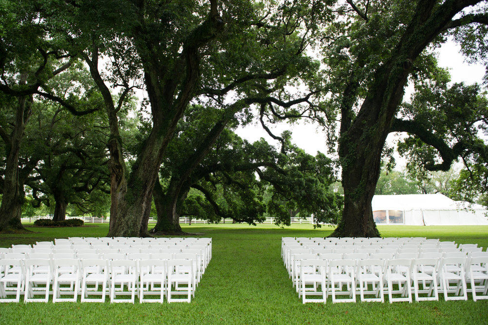 Sapphire Events | Catherine Guidry Photography | Wedding Planning | New Orleans Wedding | Stella Plantation Wedding | Blue and White Wedding | Classic Rainy Day Wedding | Outdoor Wedding | Tent Wedding | Hunter Boots | Blue and White Wedding Details | outdoor ceremony