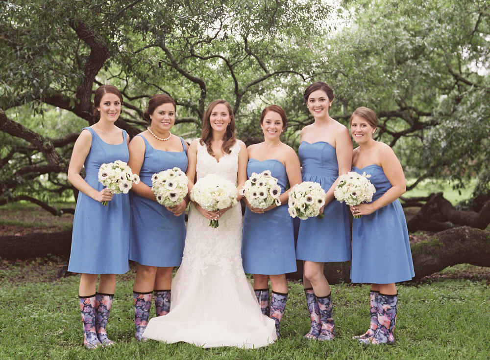 Sapphire Events | Catherine Guidry Photography | Wedding Planning | New Orleans Wedding | Stella Plantation Wedding | Blue and White Wedding | Classic Rainy Day Wedding | Outdoor Wedding | Tent Wedding | Hunter Boots | Blue and White Wedding Details | Blue bridesmaid dresses | Floral rain boots | What to do when it rains on your wedding day