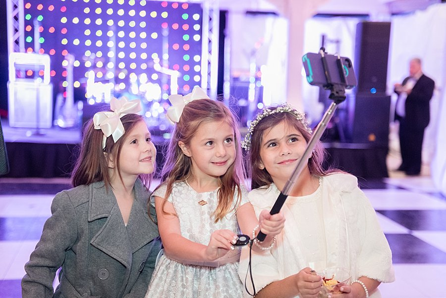 Kids and technology - they keep getting younger and younger! | Classic black and white black-tie wedding at home | Sapphire Events | Jacqueline Dallimore Photo | NYE Wedding | Estate Wedding | Tented Wedding | Monique Lhuillier gown | Blush Wedding dress | New Year's Eve wedding | Kids and selfie-sticks