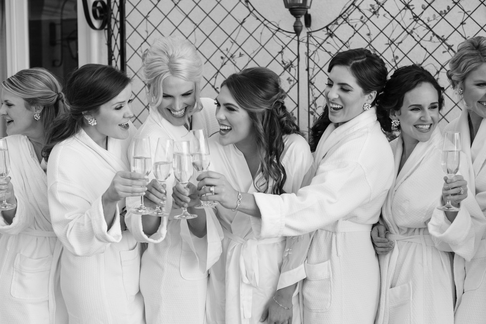 Toast with your bridesmaids! | How to transform an open ballroom with stunning decor | Sapphire Events | Greer G Photography | Board of Trade | White and Gold Wedding | Winter Wedding Inspiration | robe shot | bridesmaids | champagne toast