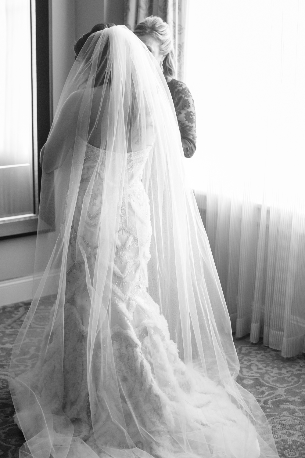 Intimate shot with mother and daughter | Getting Dressed | How to transform an open ballroom with stunning decor | Sapphire Events | Greer G Photography | Board of Trade | White and Gold Wedding | Winter Wedding Inspiration