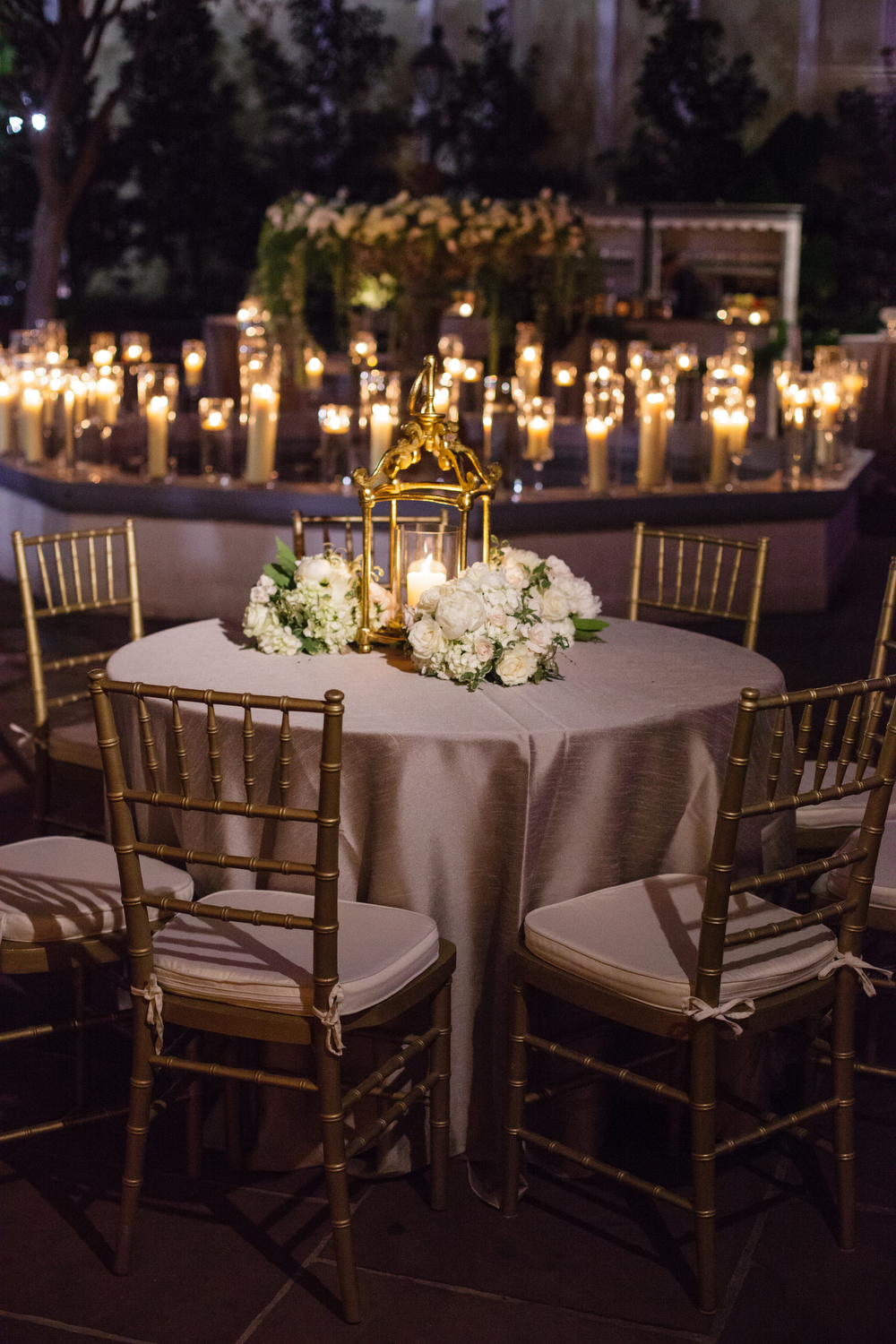 New Orleans Board of Trade courtyard decorations | Candlelight wedding | Gold French lanterns | How to transform an open ballroom with stunning decor | Sapphire Events | Greer G Photography | Board of Trade | White and Gold Wedding | Winter Wedding Inspiration | White and Green Wedding | Ballroom wedding