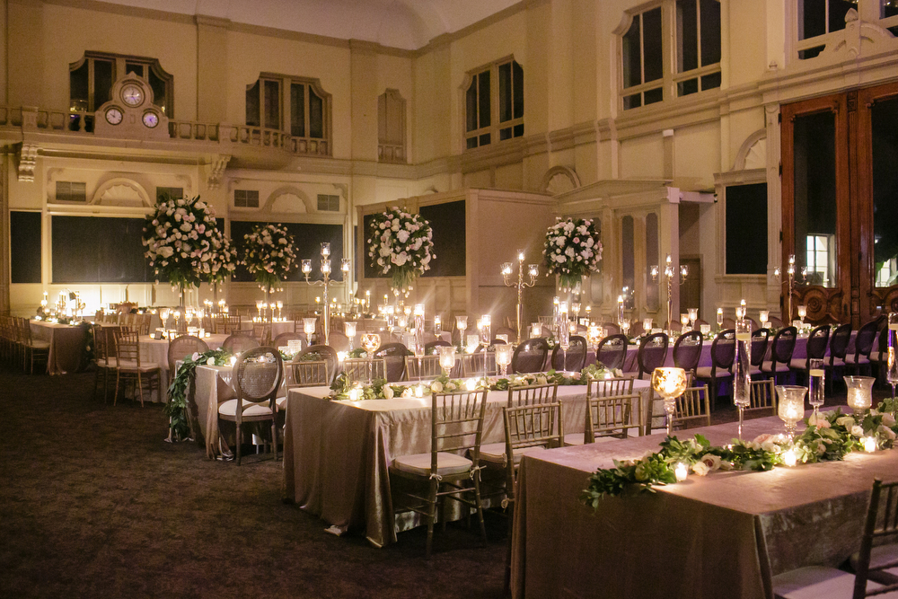 How to transform an open ballroom with stunning decor | Sapphire Events | Greer G Photography | Board of Trade | White and Gold Wedding | Winter Wedding Inspiration | White and Green Wedding | Ballroom wedding | Tall flowers with low garlands
