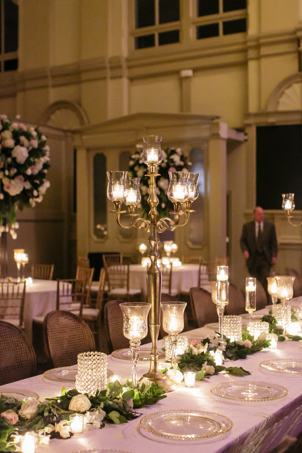 How to transform an open ballroom with stunning decor | Sapphire Events | Greer G Photography | Board of Trade | White and Gold Wedding | Winter Wedding Inspiration | White and Green Wedding | Ballroom wedding | gold candelabras | candlelight wedding