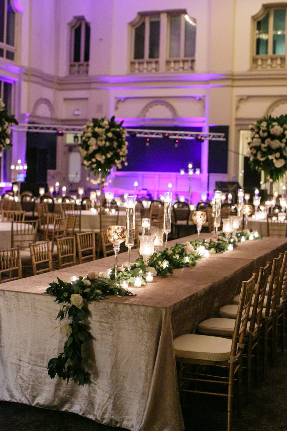 How to transform an open ballroom with stunning decor | Sapphire Events | Greer G Photography | Board of Trade | White and Gold Wedding | Winter Wedding Inspiration | White and Green Wedding | Ballroom wedding | long floral garland