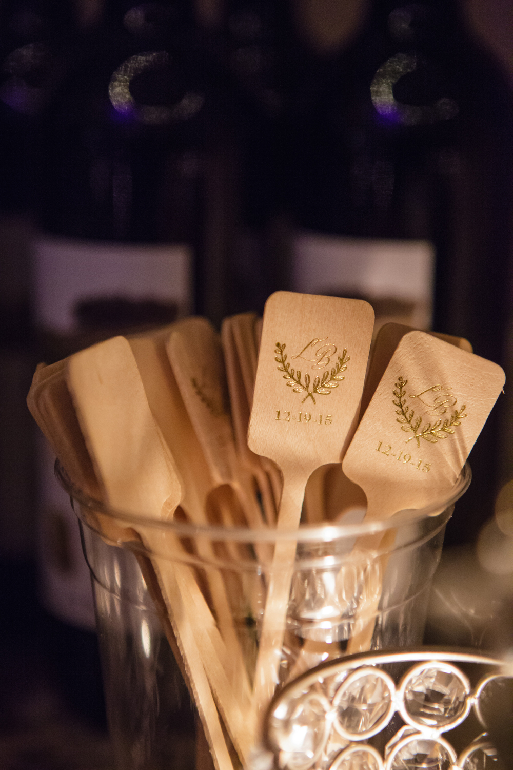 Monogrammed wooden swizzle sticks | How to transform an open ballroom with stunning decor | Sapphire Events | Greer G Photography | Board of Trade | White and Gold Wedding | Winter Wedding Inspiration | White and Green Wedding | Ballroom wedding