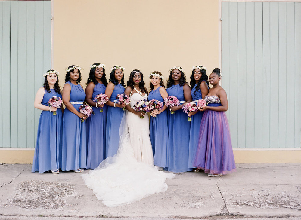 Purple ombre bridesmaid dresses | This is what happens when a bride asks her guests to wear all white | Wedding En Blanc | Sapphire Events | Erika Parker Photography Montegut House | Luxury Wedding | Courtyard wedding | French Quarter Wedding | Luxe Wedding Details