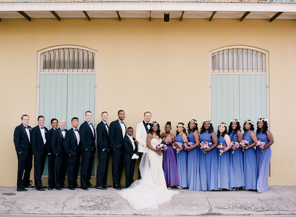 Purple ombre bridesmaid dresses | Bridal party portrait inspiration | This is what happens when a bride asks her guests to wear all white | Wedding En Blanc | Sapphire Events | Erika Parker Photography Montegut House | Luxury Wedding | Courtyard wedding | French Quarter Wedding | Luxe Wedding Details