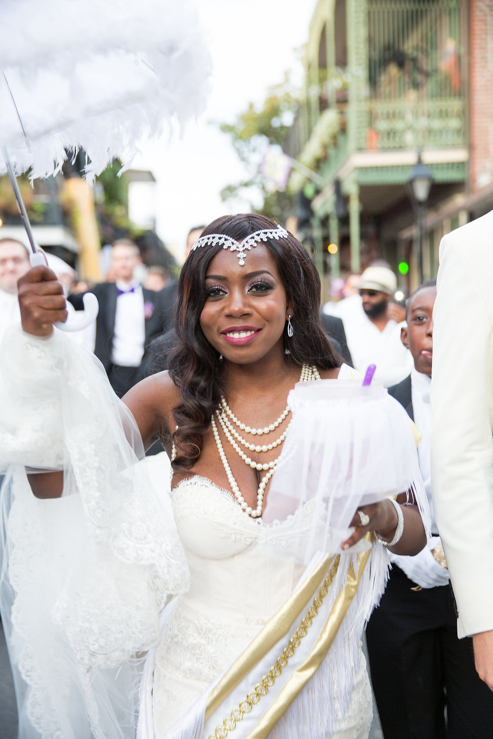 Second line parade through the French Quarter | This is what happens when a bride asks her guests to wear all white | Wedding En Blanc | Sapphire Events | Erika Parker Photography Montegut House | Luxury Wedding | Courtyard wedding | French Quarter Wedding | Luxe Wedding Details
