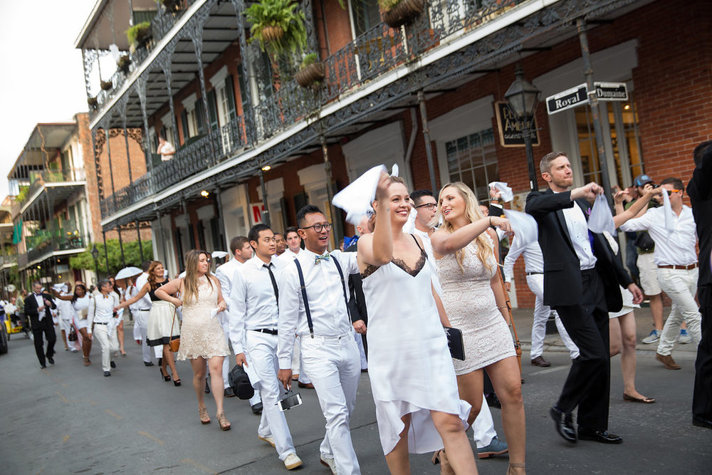 New Orleans Second Line Parade | This is what happens when a bride asks her guests to wear all white | Wedding En Blanc | Sapphire Events | Erika Parker Photography Montegut House | Luxury Wedding | Courtyard wedding | French Quarter Wedding | Luxe Wedding Details