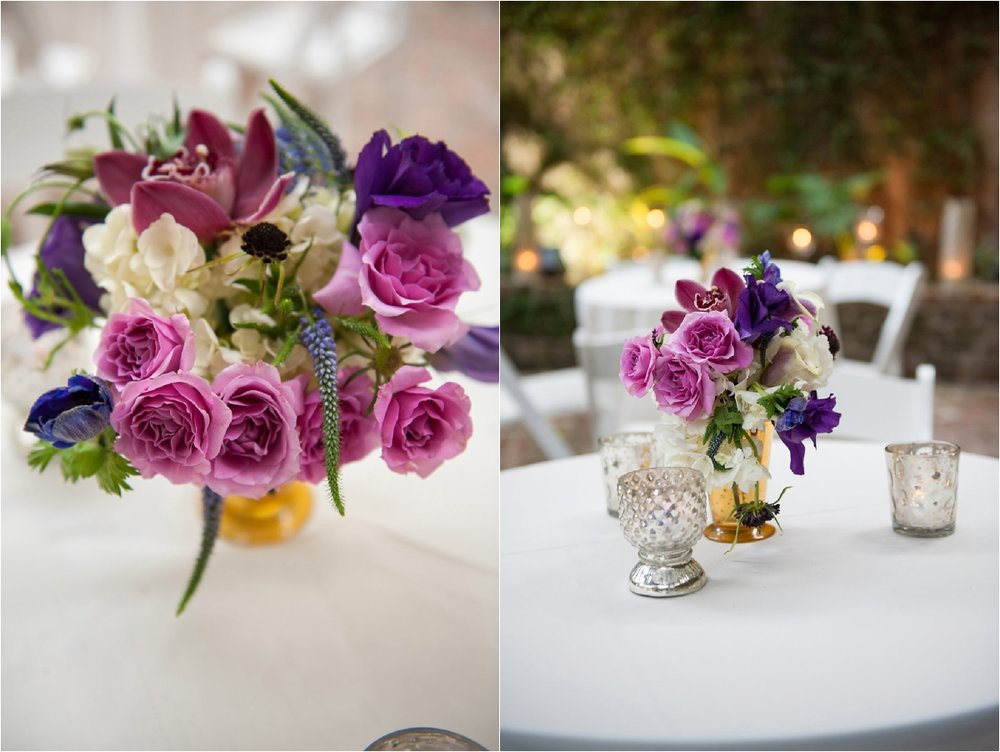 Violet and Purple centerpiece arrangements | This is what happens when a bride asks her guests to wear all white | Wedding En Blanc | Sapphire Events | Erika Parker Photography Montegut House | Luxury Wedding | Courtyard wedding | French Quarter Wedding | Luxe Wedding Details | Kim Starr Wise Florals