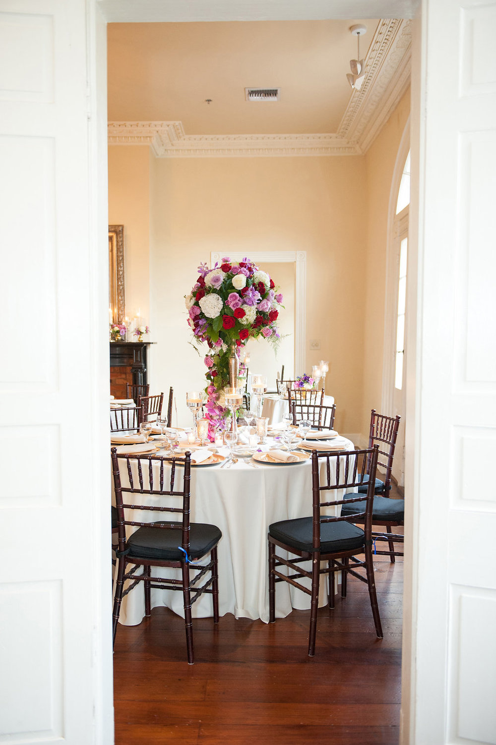 Montegut House INterior Mansion | Tall Centerpieces | This is what happens when a bride asks her guests to wear all white | Wedding En Blanc | Sapphire Events | Erika Parker Photography Montegut House | Luxury Wedding | Courtyard wedding | French Quarter Wedding | Luxe Wedding Details