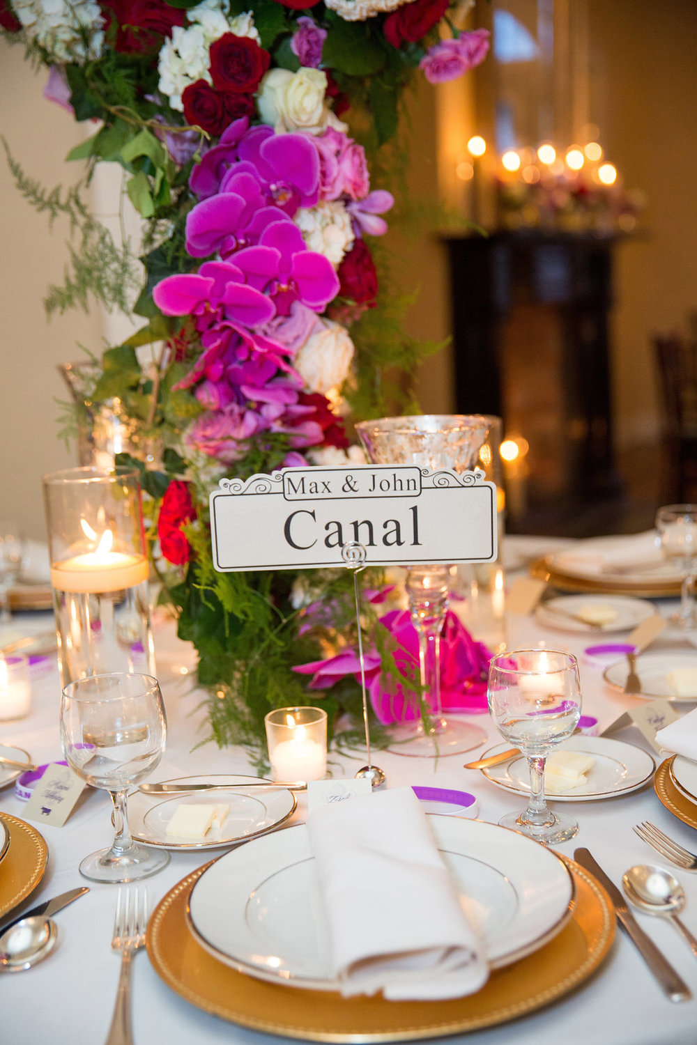 Purple Orchids and greenery centerpieces | This is what happens when a bride asks her guests to wear all white | Wedding En Blanc | Sapphire Events | Erika Parker Photography Montegut House | Luxury Wedding | Courtyard wedding | French Quarter Wedding | Luxe Wedding Details