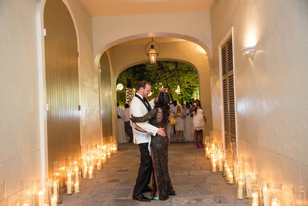 Montegut House Carriageway with candles | Luminous Events | This is what happens when a bride asks her guests to wear all white | Wedding En Blanc | Sapphire Events | Erika Parker Photography Montegut House | Luxury Wedding | Courtyard wedding | French Quarter Wedding | Luxe Wedding Details