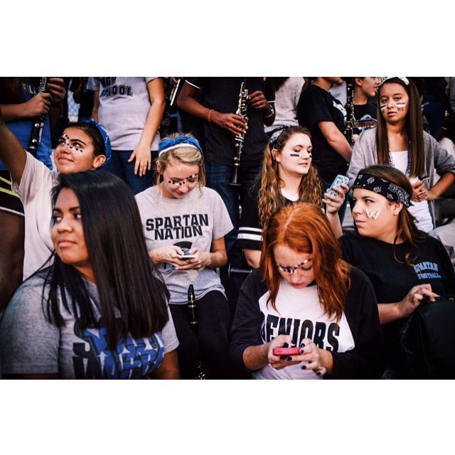 Teens during half time at a Friday night Spartan-Raiders football game … Just millennials watching sports 🏈😎�