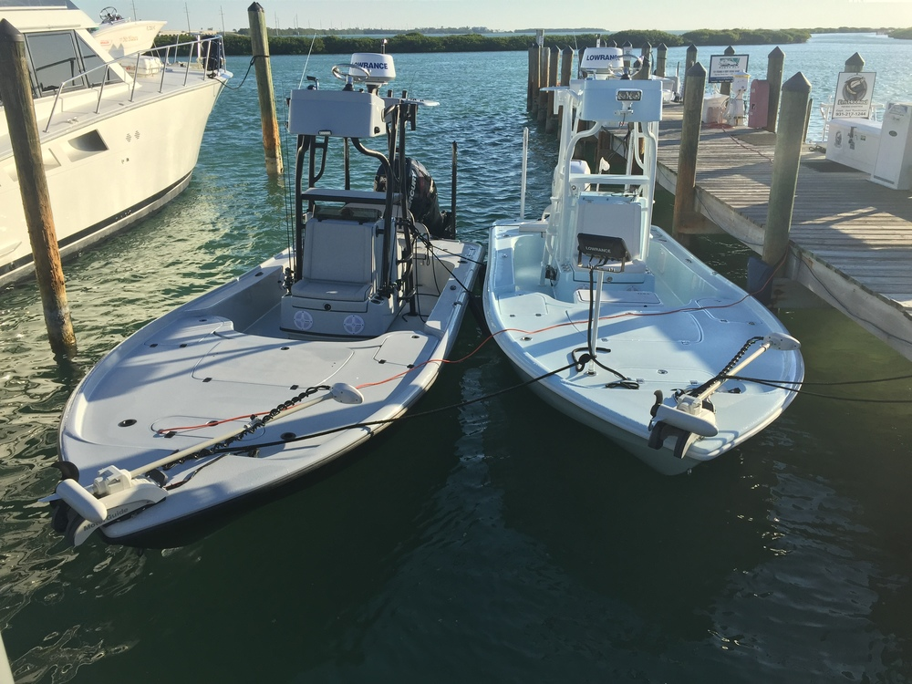 Tom Rowland's 24 Yellowfin Bay Boat pictured left, Rich Tudor's 24 Yellowfin Bay Boat pictured right.  Tom prefers the Whisper Gray deck with all black hardware while Rich likes the light Blue with all White trim.  Both boats are weapons.