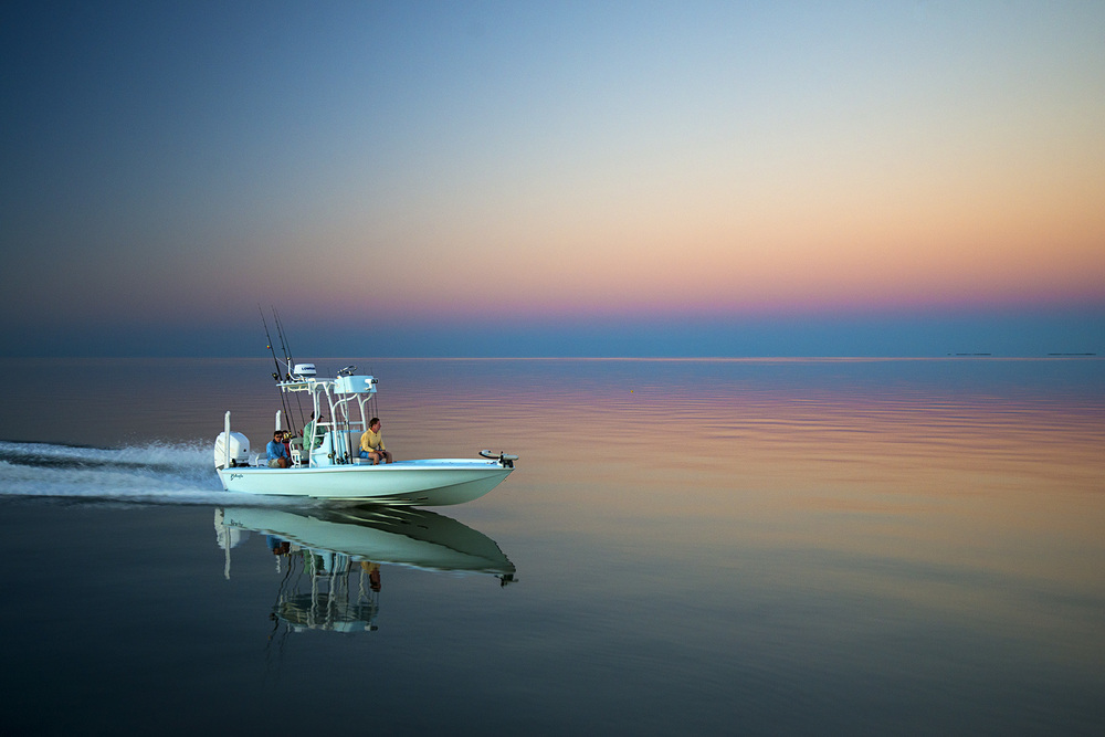 The Yellowfin 24 Bay Boat with Mercury 300 Verado running through Florida Bay at sunset