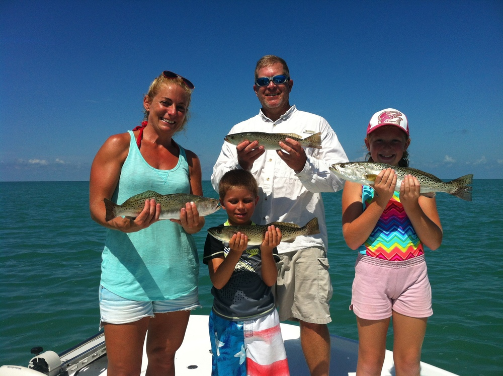 A happy family on a Saltwater Experience Charter with Mike O'Dell