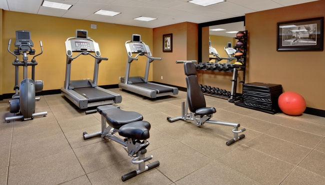 Here is a typical hotel fitness center.  A few treadmills, a couple of benches and hidden in the corner, you might find a small rack of dumbbells
