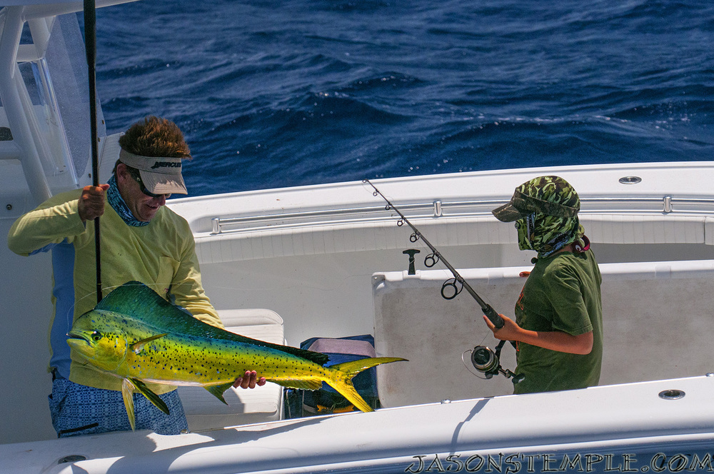 Rich's son sporting a green Saltwater Experience Buff
