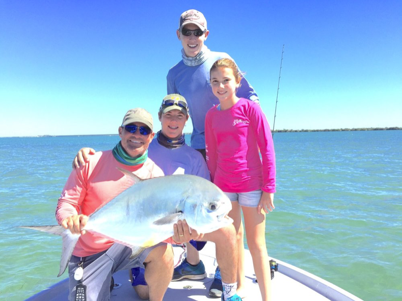 tom-rowland-of-saltwater-experience-and-catches-a-permit-with-family