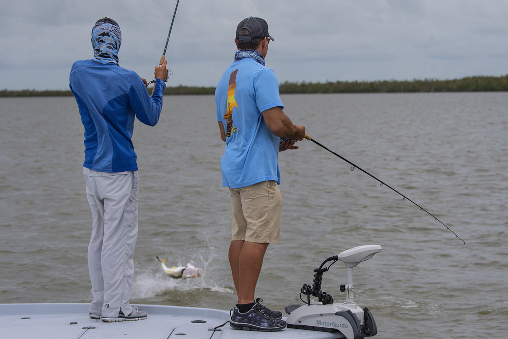 Richard Black and Tom Rowland stand side-by-side fishing together in the Everglades