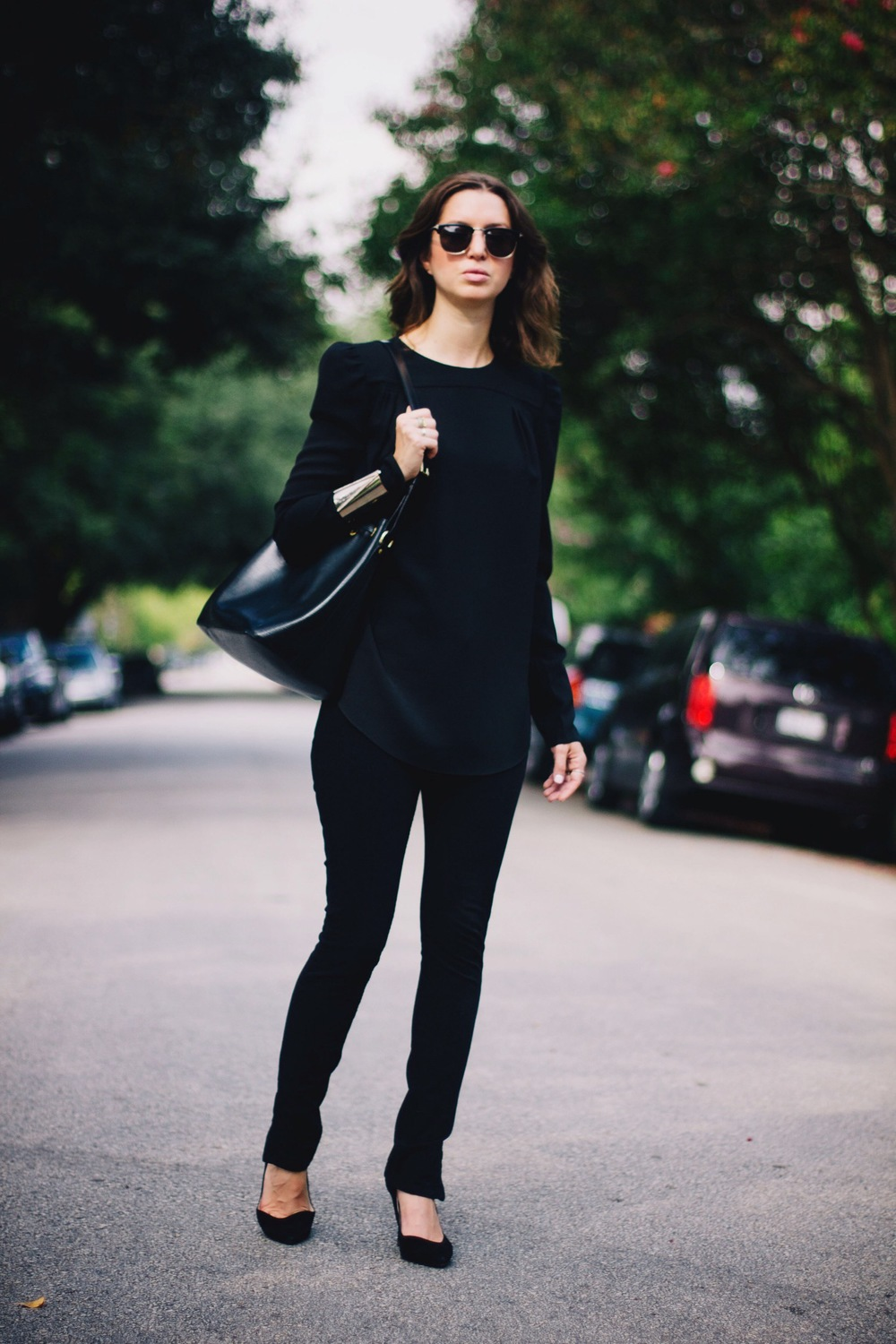 Carven puffy shoulder blouse with all black outfit