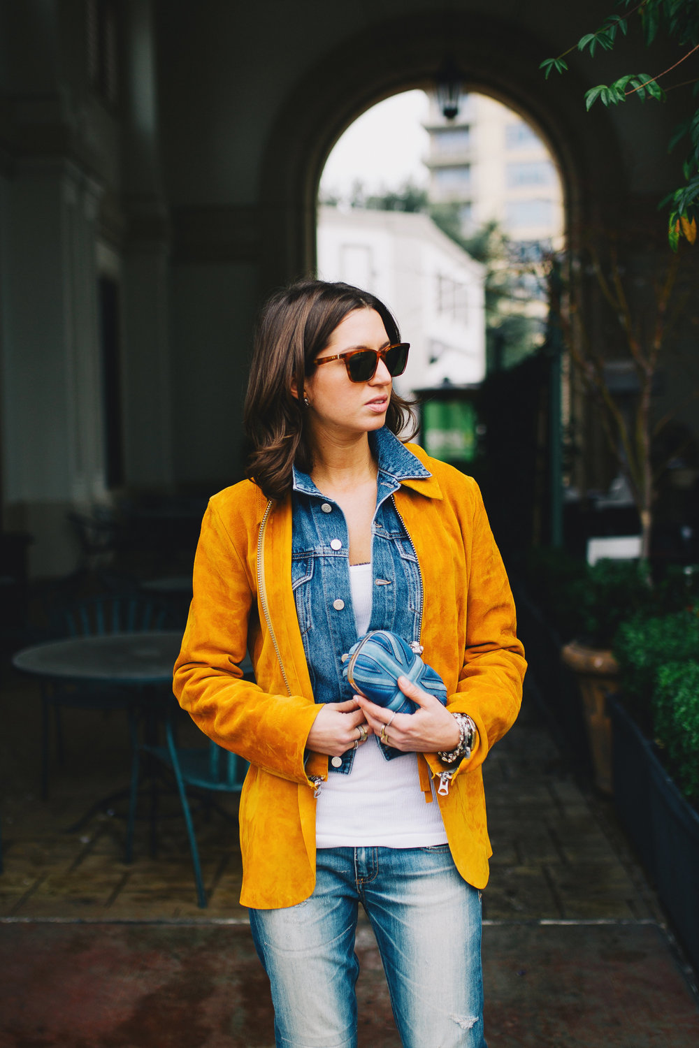 Tan suede and denim layered jackets