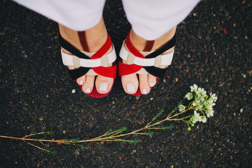 YSL Tribute sandals in red, white, and navy.