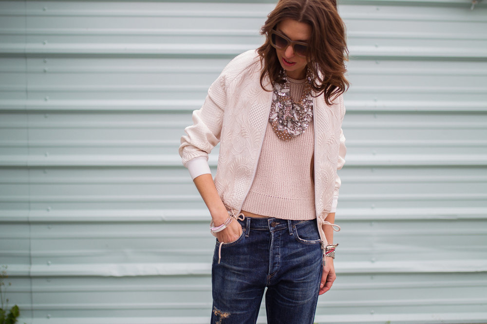Blush Phillip Lim bomber jacket, kniw top, and Mignonne Gavigan necklace
