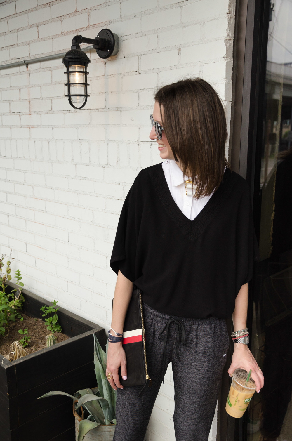 Ath-leisure look including Outdoor Voices drawstring pants, Tienda Ho pull over top, and Clare Vivier clutch