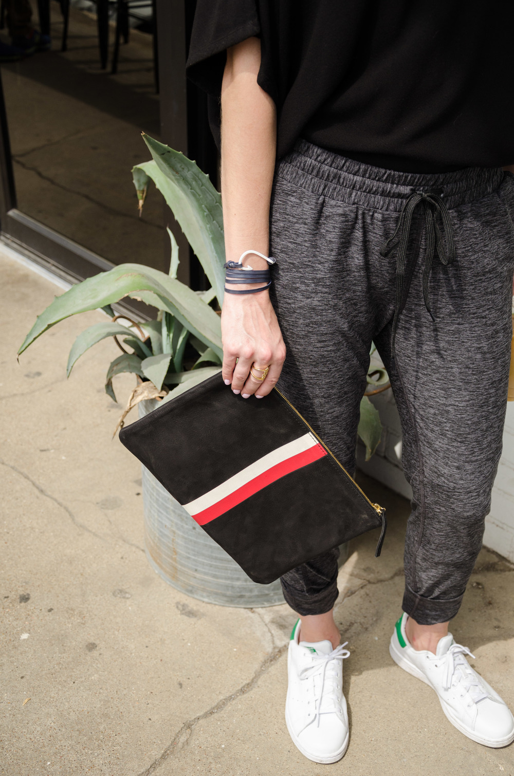 Athletic leisure look with Outdoor Voices drawstring pant, Clare Vivier clutch, and Stan Smith Adidas originals