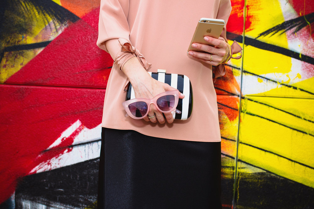 Summer cocktail details including striped Surpui clutch