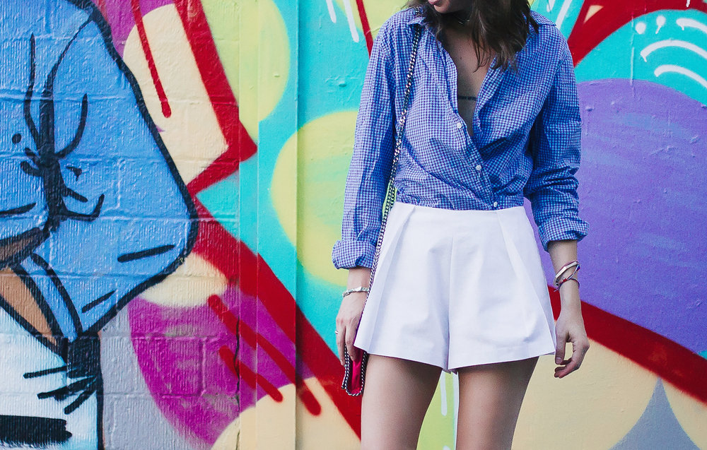 Wrap button down with crisp white shorts by The Shoe Diet