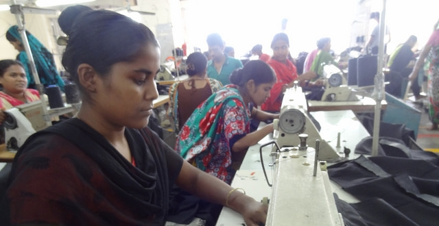 Workers assemble garments by hand at a factory in Dhaka. Photo credit Bishawjit Das.