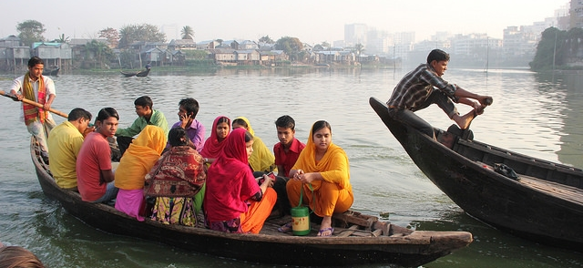 Garment workers commuting by boat to work. Photo credit Bishawjit Das.