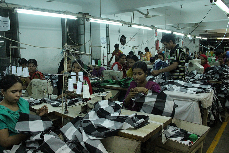 Small production factory puts finishing touches on a garment order in Dhaka, Bangladesh.