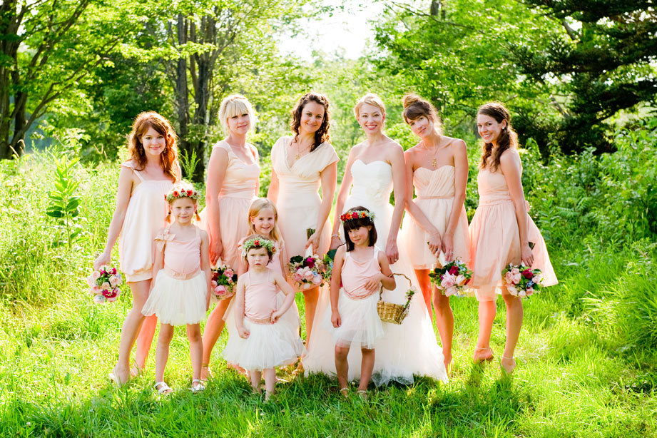 This was one of my first groups!  I created all the dresses for the bridal party to sit well with the brides dress.  Each bridesmaid and flower girl got their own special design.  I mixed different silhouettes with different fabrics and texture but kept them all feeling like they were a part of the same group.  It was  a really fun task customizing each dress to each lady and little lady :)