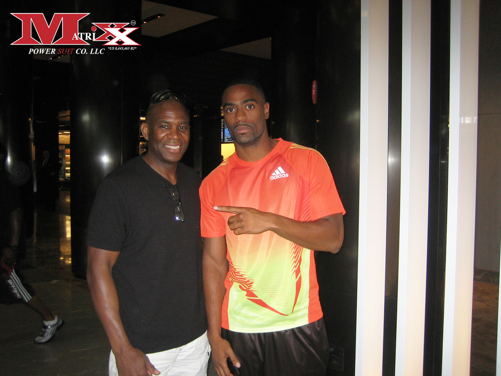 Calvin w Olympic Runner Tyson Gay 2012