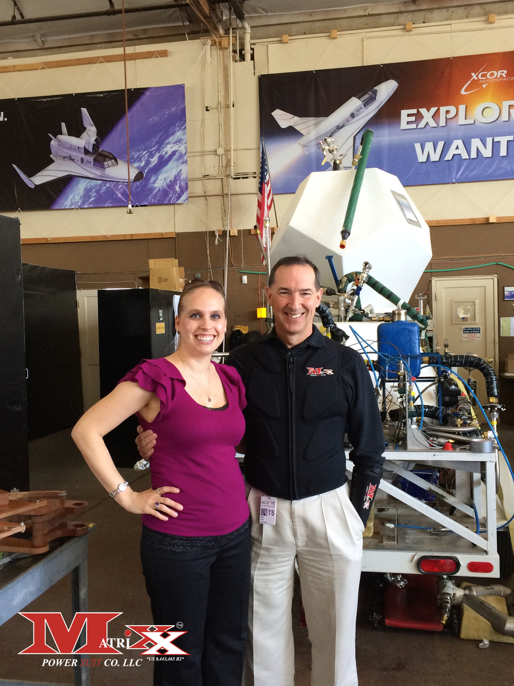 Holly w test pilot Brian Binnie @ XCOR Aerospace 10-11-2014