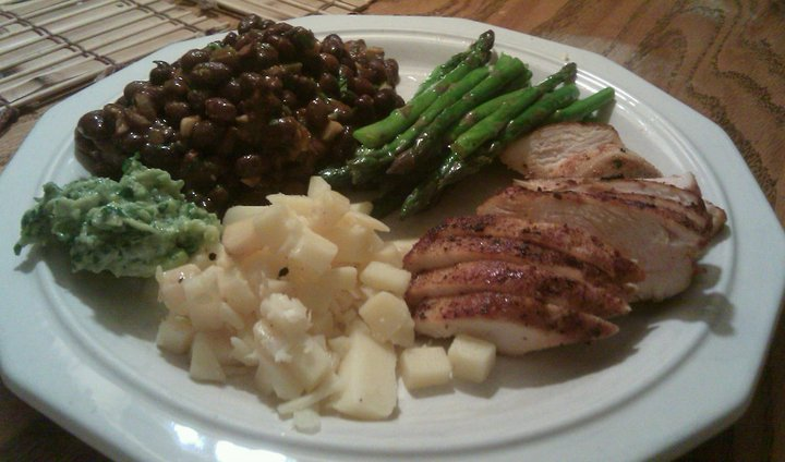 A simple family meal. Chicken Fajitas, black beans, sauteed asparagus, guacamole, and cheddar cheese.