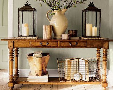 Console table with varied height decorative items.