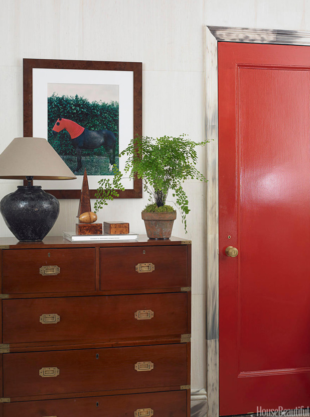 This red door fits nicely in the traditional space.