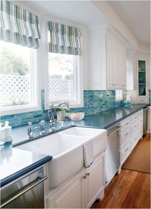 This kitchen looks more complete with this simple window treatment.