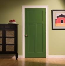 The green door is several shades darker than the green walls.  3 panels are attractive.