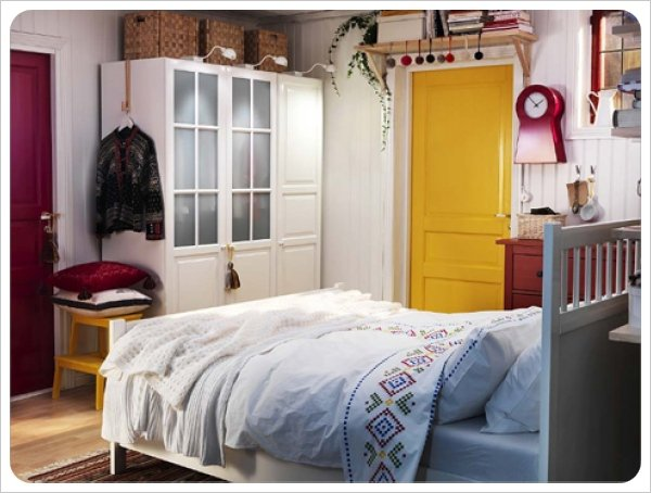 Both a red and yellow door in this one room. This works with white walls and trim.