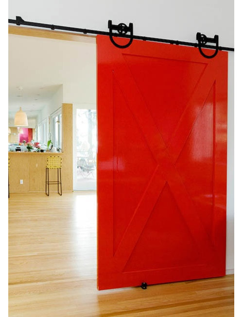 High gloss red barn door!  Fun with black hardware.