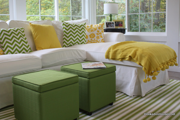 Green Ottomans And Yellow Throw Sunroom