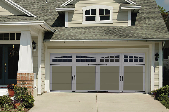 This garage door reflects the craftsman style of the home.  Look closely, it is one door made to look like two.
