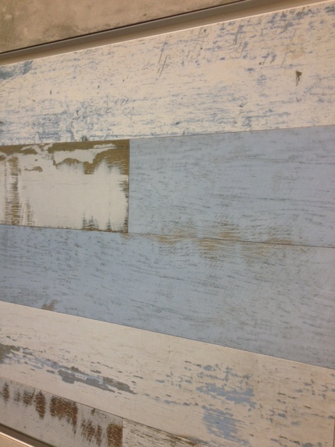 Ceramic tile that looks like distressed wood.  Perfect for wainscoting in a beach or mountain house.